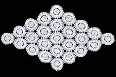 Rhomboid lace tablecloth isolated on black background, floral pattern. White rhomboid lace tablecloth isolated on black background, floral pattern. Cute out and Royalty Free Stock Photography