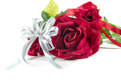 White ribbon with Bouquet of red roses on white Royalty Free Stock Photos