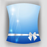 White ribbon and bow on blue background Royalty Free Stock Photo