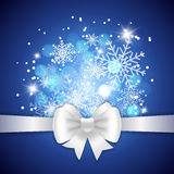 White ribbon and bow on blue background. Stock Images