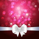 White ribbon and bow on crimson background Royalty Free Stock Images