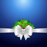 White ribbon,  bow and holly berry on blue background Stock Image
