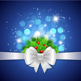 White ribbon,  bow and holly berry on blue background Stock Photo