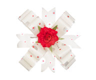 White ribbon bow with red flower isolated on white Stock Photos