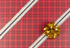 White ribbon and bow on red gift paper Stock Photo