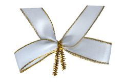 White ribbon bow. With a gold border isolated on white background royalty free stock image