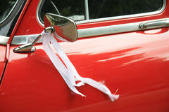 White ribbon car decoration for a wedding Royalty Free Stock Photos