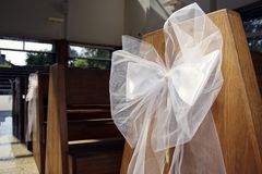 White ribbon in church. Wide angle lens stock images