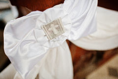 White ribbon decoration with cross at church ceremony of wedding Royalty Free Stock Images