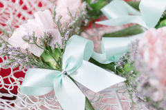 White ribbon and decorations flower. - Shallow of focus stock photo