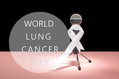 Lung cancer ribbon, white ribbon, a symbol of the fight against lung cancer. The white ribbon, a symbol of the international or world day of fight against lung stock photography