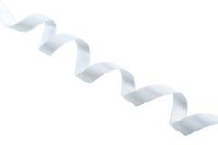 White ribbon on a white background Stock Photos