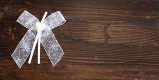 White ribbon on wood Royalty Free Stock Photography