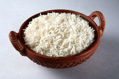 White rice. In a traditional bowl Stock Photos