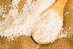 White rice. Lying on a bamboo spoon (a cloth from flax Royalty Free Stock Photos