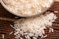 White rice. On brown background with bowl Stock Photos