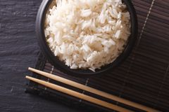 White rice in a black bowl. horiozntal top view Royalty Free Stock Photo