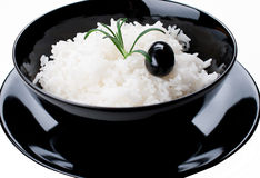 White rice in black bowl isolated Stock Images