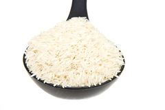 White Rice in Black Ladle Stock Image