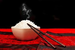 White rice in a bowl. With chopsticks royalty free stock photos