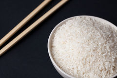 White rice in bowl and chopsticks Royalty Free Stock Photo