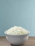 White rice in a bowl of cooked rice in bowl and on the background of old wooden planks. Royalty Free Stock Image