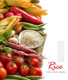 White rice in bowl and fresh vegetables Royalty Free Stock Image