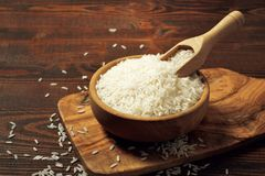 White rice in bowl. White rice in wooden bowl stock photo