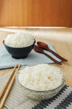 White rice in bowl with wooden chopsticks Stock Images