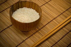 White rice in bowl on wooden mat Royalty Free Stock Photo