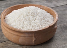 White rice in bowl on the wooden table. Close up photo Stock Image