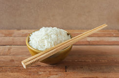 White rice in brown bowl with wood chopsticks Stock Photography
