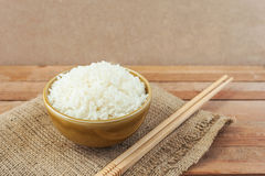 White rice in brown bowl with wood chopsticks Stock Photo