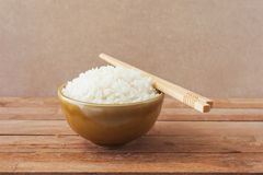 White rice in brown bowl with wood chopsticks Stock Image