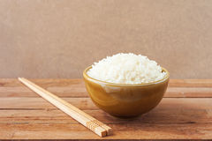 White rice in brown bowl with wooden chopsticks Stock Image