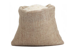 White rice in burlap sack isolated on white background Stock Images