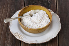 White rice in a ceramic bowl on rustic wooden background Stock Image