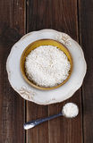 White rice in a ceramic bowl on rustic wooden background. Short-grain rice in a rustic ceramic bowl on a dark wooden background. Top view royalty free stock images
