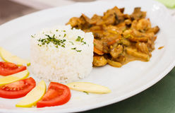 White rice, chicken meat, mushrooms and fresh vegetables Royalty Free Stock Photos