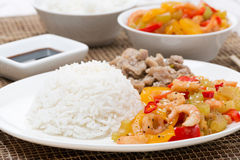 White rice, chicken and vegetables with shrimp on the plate Stock Image