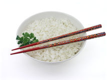 White Rice And Chopsticks. White rice in a bowl with chopsticks and parsley Stock Photos