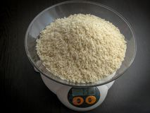 White rice on a digital scale. stock photo