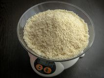 White rice on a digital scale. royalty free stock photo