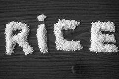 White rice forming a sign Stock Photos