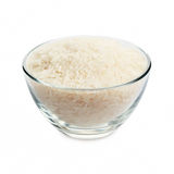 White rice. In glass bowl isolated on white background stock image