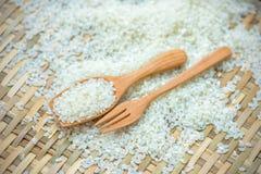 White rice. Grain rice in spoon Stock Photo