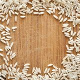 White rice grains on wooden cutting board, in square format for social media, banners, and backgrounds. royalty free stock photography