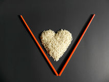 White rice heart placed letter V Stock Image