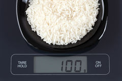 White rice on kitchen scale Royalty Free Stock Images