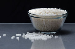 White rice measured in cup Royalty Free Stock Images